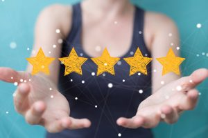 woman holding up 5 stars